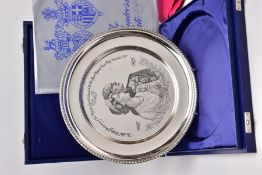 A SILVER COMMEMORATIVE PLATE, the circular plate with engraved image of Queen Elizabeth II and