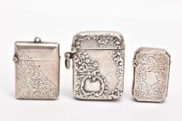 THREE SILVER VESTAS, the first a late Victorian case, of a rectangular form, cut off corners,