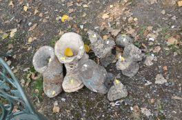 SEVEN COMPOSITE GARDEN FIGURES including two boots, a pig, a dove, a gnome etc