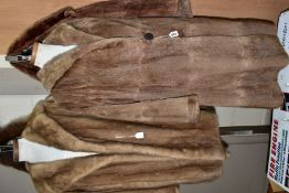 TWO FUR COATS, etc, comprising a pale brown coney fur coat approximate size 14/16, small hole near