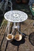 A CAST ALUMINIUM GARDEN TABLE, 60cm diameter with pierced fretwork and three glazed plat pots (4)