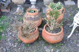 FOUR VARIOUS TERRACOTTA PLANTERS including a water ewer with two handles 56cm height