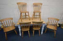A PINE AND PARTIALLY PAINTED KITCHEN TABLE with six chairs including two carvers (7)