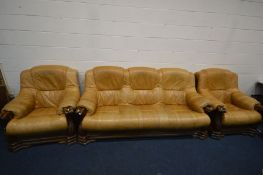 AN ITALIAN STYLE BROWN LEATHER AND WOODEN FRAMED THREE PIECE LOUNGE SUITE, comprising a sofa, length