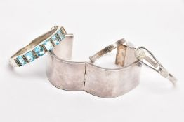 FOUR WHITE METAL BANGLES, the first a plain polished square shaped bangle, fitted with a push pin