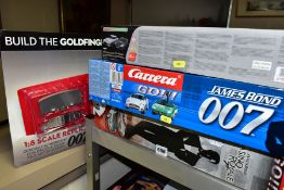 JAMES BOND, three remote control race car and tracks (boxed), comprising the micro-scalextric