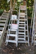 FOUR SETS OF ALUMINIUM STEP LADDERS of various sizes, largest height 2.1m