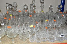A QUANTITY OF CUT GLASS AND CRYSTAL, to include over seventy pieces, nine decanters with stoppers,
