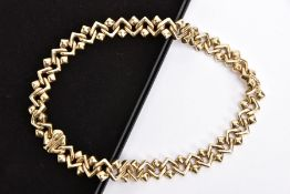 A 9CT GOLD FANCY LINK CHIAMPESAN COLLAR NECKLACE, Chervon style links, fitted with an integrated