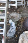 A COMPOSITE SHELL SHAPED BIRD BATH (Sd) height 48cm and a composite garden figure of a seated lady