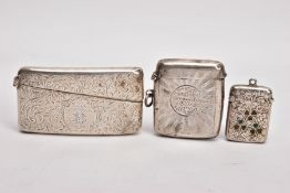 A SILVER CARD CASE AND TWO VESTAS, the card case decorated with an engraved foliate design and
