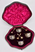 A CASED SET OF FOUR LATE VICTORIAN SILVER SALTS, each with embossed swag floral decoration and