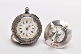 A SILVER FOXES MASK WINE POURER AND AN OPEN FACE POCKET WATCH, the wine pourer in the form of a