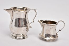 TWO EARLY 20TH CENTURY SMALL SILVER CREAM JUGS, the first of baluster shape with stepped circular