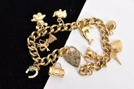 A 9CT GOLD CHARM BRACELET, fitted with nine charms in forms such as a rabbit, heart locket and