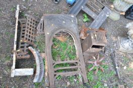 TWO EDWARDIAN CAST IRON FIRE BACKS with fire grates, a wrought iron weather vane (missing top and