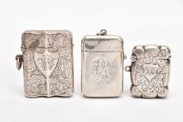 TWO LATE VICTORIAN SILVER VESTAS, AN EARLY 20TH CENTURY VESTA, AND A SMALL CERAMIC FIGURE, the first