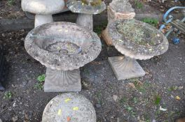 A PAIR OF LARGE COMPOSITE GARDEN URNS with fluted baluster, diameter 62cm x height 54cm (one