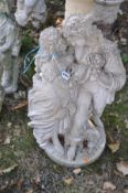 A COMPOSITE GARDEN FIGURE OF TWO SWEETHEARTS EMBRACING height 77cm