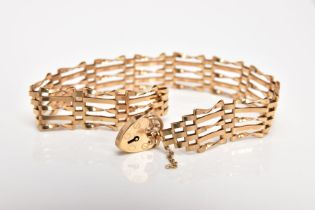 A 9CT GOLD GATE BRACELET, approximate width 6.6mm, fitted with a heart clasp, also fitted with a