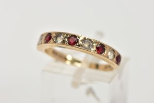 A 9CT GOLD GARNET AND SPINEL HALF ETERNITY RING, designed with a row of circular cut garnets