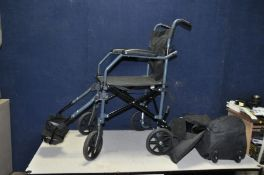 A DRIVE MOBILITY TRAVELITE FOLDING WHEELCHAIR with foot rests and carry bag