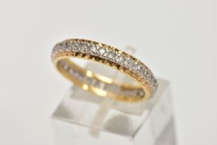 A YELLOW METAL FULL ETERNITY RING, set with colourless spinels, textured gold rim, stamp mark