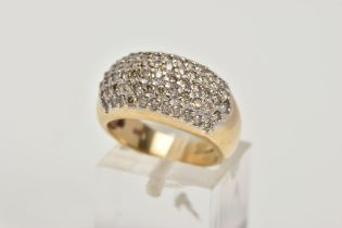 A 9CT GOLD DIAMOND ENCRUSTED CLUSTER RING, wide band with the ring head encrusted with round