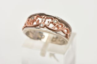 A CLOGAU SILVER AND GOLD RING, designed with a rose gold openwork centre, set with single cut