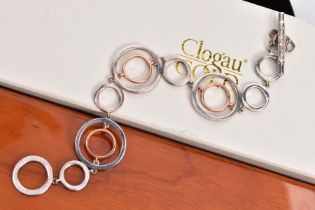 A CLOGAU SILVER AND GOLD BRACELET, openwork rose gold and silver circular links, fitted with a