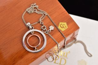 A CLOGAU PENDANT NECKLACE, the pendant of an openwork circular design, fitted with a tapered bail