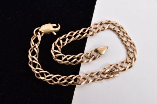A YELLOW METAL DOUBLE CURB LINK BRACELET, double curb links, fitted with an AF lobster claw clasp,