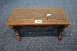 A BEECH FOLDING STAND with a pair of carved bears, width 30cm x depth 15cm x height 15cm