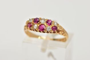 AN EARLY 20TH CENTURY 18CT GOLD RUBY AND DIAMOND BOAT RING, the ring head of an oval form, set