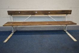 A CAST IRON AND PINE SLATTED SCHOOL BENCH, with a lift up seat, length 157cm (condition - some