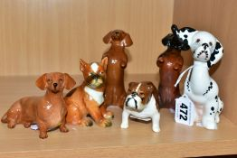 FIVE SMALL BESWICK DOG FIGURES AND ANOTHER SIMILAR, comprising Puppit Dog, model No 1002,
