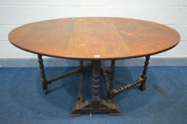 AN OAK OVAL TOP GATE LEG TABLE, on bobbin turned supports and stretchers, open length 151cm x closed