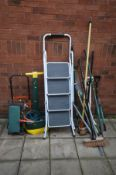 A COLLECTION OF GARDEN TOOLS AND ITEMS to include a rake, fork, spade, brushed, sack truck etc and a