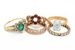 FIVE GEM SET RINGS, to include a garnet and opal cluster ring, an oval blue topaz ring, a heart