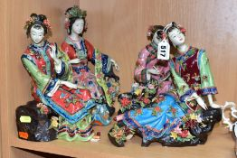 FOUR SECOND HALF 20TH CENTURY JAPANESE POTTERY FIGURES OF SEATED LADIES, florally encrusted and