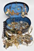 A JEWELLERY BOX WITH CONTENTS, a black oval jewellery box, with contents of costume jewellery to