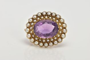 A LATE 19TH EARLY 20TH CENTURY AMETHYST AND SEED PEARL BROOCH, of an oval form, centring on an