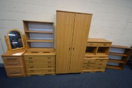 A LARGE QUANTITY OF PINE EFFECT BEDROOM FURNITURE, to include a double door wardrobe, two single