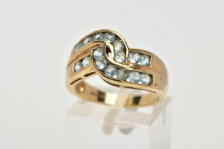 A 9CT GOLD AQUAMARINE DRESS RING, of a cross over style, set with two rows of circular cut
