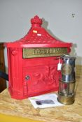 A CONTEMPORARY LETTER BOX IN A VINTAGE STYLE AND A MINERS LAMP, comprising brass and chrome