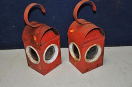 A PAIR OF VINTAGE KEROSENE WARNING LAMPS in red, stamped Chalwyn with two red and one clear lens