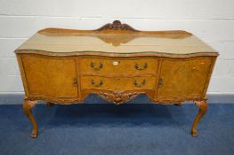 A REPRODUCTION VICTORIAN STYLE BURR WALNUT SERPENTINE SIDEBOARD, with a raised back, cupboard