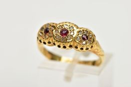 A 1930'S 18CT GOLD GARNET AND DIAMOND RING, designed as three graduated circular garnets within
