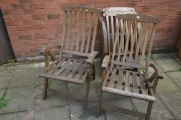 A SET OF FOUR LILO WOODEN SLATTED FOLDING DECK CHAIRS