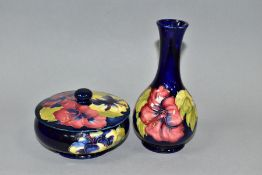 A MOORCROFT POTTERY POWDER BOWL AND COVER AND A BULBOUS SHAPED VASE, both in Hibiscus pattern on a